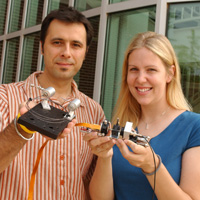 Boris Mizaikoff displays a prototype of the gas phase sensor, while graduate student Christy Charlton holds the liquid phase prototype