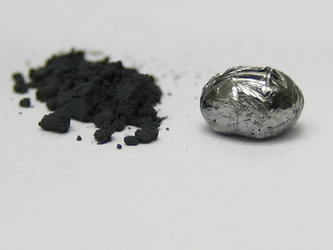 UCLA scientists have made rhenium diboride, an �ultra-hard material.� Rhenium diboride is seen here in powder form (left), made from heating the elements in a furnace, and as a pellet made by a procedure called arc melting.