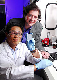 Georgia Tech researchers Joe Perry and Philseok Kim display a capacitor array device made with a barium titanate nanocomposite.