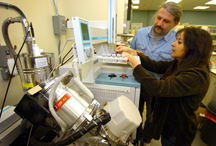 Discovery Park researchers Jiri Adamec, left, and Maria Sepulveda analyze molecule samples taken using gas chromatography coupled with a mass spectrometer at a laboratory in Discovery Park's Bindley Bioscience Center. Adamec, a faculty researcher in metabolomics and proteomics, and Sepulveda, an assistant professor in the Department of Forestry and Natural Resources, are examining the development of biomarkers in fish that have been exposed to chemicals and contaminants such as herbicides. The research has applications in how humans might adversely react to the same chemicals. Public tours beginning Oct. 1 at Discovery Park will include the Bindley Bioscience and Birck Nanotechnology centers as well as Mann Hall and the Burton D. Morgan Center for Entrepreneurship. (Purdue News Service photo/ David Umberger)