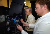 James Leary, from left, a School of Veterinary Medicine professor of nanomedicine and professor of biomedical engineering at Purdue, and Michael Zordan, a graduate student in biomedical engineering, prepare samples for a special high-speed cell sorter at Discovery Park's Bindley Bioscience Center. This instrument, located in Bindley's Molecular Cytometry Laboratory, is a key part of a $4.5 million project that combines molecular imaging, cytometry and nanomedicine to diagnose and treat illnesses and diseases at the molecular level. (Purdue News Service photo/David Umberger)