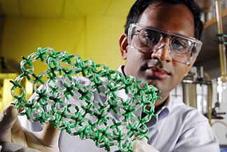 Sankar Nair, an assistant professor in the Georgia Tech School of Chemical and Biomolecular Engineering, holds a model showing the structure of metal oxide nanotubes he is developing. The research could lead to a technique for precisely controlling the dimensions of the structures.