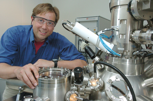 Matthias Bode, Center for Nanoscale Materials, is shown with his enhanced spin polarized scanning tunneling microscope (SP-STM). His enhanced technique allows scientists to observe the magnetism of single atoms. Use of this method could lead to better magnetic storage devices for computers and other electronics.