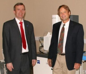 Frank Averdung (left), President and General Manager of Carl Zeiss SMT Inc. hands over the first of a total of eight advanced microscope systems to Eric Martin, technical director at Harvard's CNS. (Photo: Business Wire)