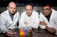 Clarkson University Physics Professor Igor Sokolov and his team have discovered a method of making the brightest ever synthesized fluorescent silica particles. Here (left to right) Sokolov works in his laboratory with graduate student Dmitry Volkov and postdoctoral fellow Sajo P. Naik. sokolov-particles: Fluorescent image of a physical mixture of fluorescent silica particles of different shapes with different dyes.