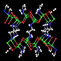 The crystal structure of -ZnTe(en)0:5, determined by single-crystal X-ray diffraction. Two-monolayerthick ZnTe slabs are interconnected by ethylenediamine (C2N2H8) molecules bonded to zinc atoms. Zn-Green, Te-Red, N-Blue,and C-Gray. Hydrogen atoms are omitted for clarity.