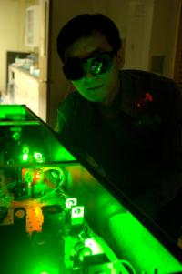 Guo in lab at the Institute of Optics at the University of Rochester (photo credit Richard Baker, University of Rochester)