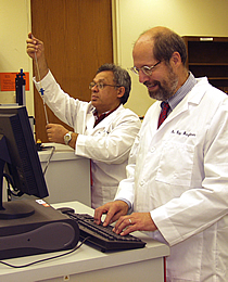 Dr. Ray Baughman (right) and Dr. Anvar Zakhidov work with a magnetometer at UT Dallas.