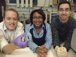 From left, Broad Institute postdoctoral associate Kris Wood, Bayer Professor of Chemical Engineering Paula Hammond and chemical engineering graduate student Dan Schmidt show the thin film they have developed. The film releases drugs and other chemical agents upon application of a small electrical field.