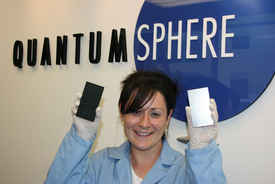 Kimberly McGrath, PhD, Director of Fuel Cell R&D, QuantumSphere, Inc., holds QSI-Nano NiFe coated electrode (left) vs. standard stainless steel electrode for hydrogen generation through water electrolysis.