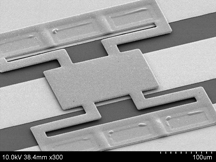 This is an image of a tiny switch called a radio-frequency micro-electromechanical system. The device has a length of about 400 microns, or millionths of a meter, or roughly four times the width of a human hair. The National Nuclear Security Administration will award a $17 million cooperative agreement for a research center at Purdue's Discovery Park to develop advanced simulations to perfect the devices for commercial and defense applications. (Dimitrios Peroulis, Purdue School of Electrical and Computer Engineering, Birck Nanotechnology Center)