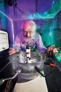 Sandia researcher Peter Roth prepares to blow up a battery to see how robust it is. The work is part of the DOE-funded FredomCAR program. (Photo by Randy Montoya)