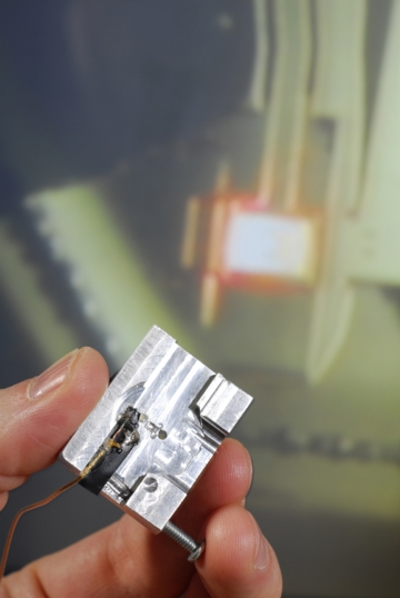 An AFM holder adapted so that the FIRAT probe can be used on existing AFM systems. The FIRAT probe can simultaneously measure topography and material properties including adhesion, stiffness, elasticity and viscosity. (Georgia Tech Photo: Gary Meek)
