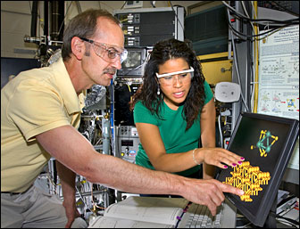 Michael White and Melissa Patterson review an image of a molybdenum sulfide nanocluster.