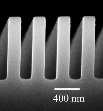 A scanning electron micrograph, taken with an electron microscope, shows the comb-like structure of a metal plate at the center of newly published University of Florida research on quantum physics. UF physicists found that corrugating the plate reduced the Casimir force, a quantum force that draws together very close objects. The discovery could prove useful as tiny �microelectromechanical� systems -- so-called MEMS devices that are already used in a wide array of consumer products -- become so small they are affected by quantum forces.