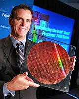 Tom Kilroy, vice president and general manager of Intel's Digital Enterprise Group, displays a wafer from Intel's new Xeon 7400 Processor family, formerly code-named Dunnington, Monday, September 15, 2008, at a news conference in San Francisco. Intel today announced the availablity of seven high-end server processors, including the world's first six-core, x86 chip under the Intel Xeon 7400 Processor Series moniker. (Photo for Intel by Court Mast)