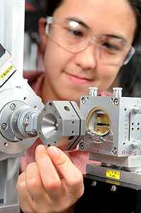 Argonne scientist Karena Chapman examines the diamond anvil pressure cell at the Advanced Photon Source.