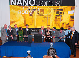 Legislators and other dignitaries join University President Michael Hogan, center, and Gov. M. Jodi Rell, fifth from right, for a ribbon-cutting at the nanobionics �clean room� on Oct. 20. From left are Prof. Harris Marcus, Mary Ann Hanley, former U.S. Rep. Rob Simmons, State Rep. Denise Merrill, State Sens. Donald E. Williams Jr., Gary LeBeau, and Eileen Daily, Vinod Makhijani, and Higher Education Commissioner Michael Meotti. Photo by Gerald Ling