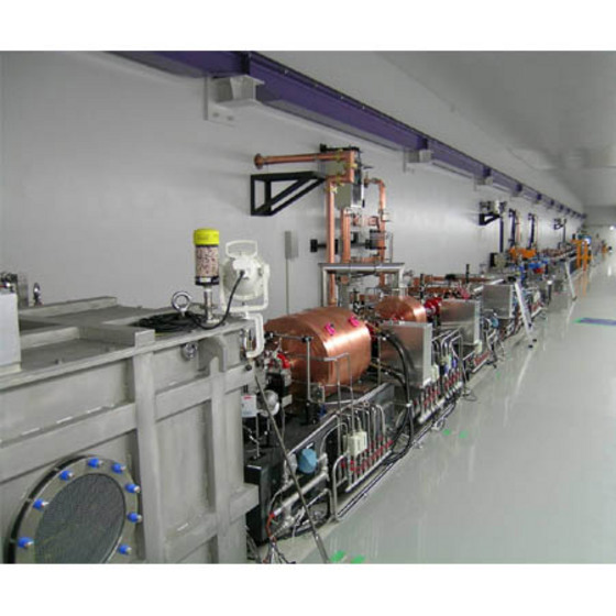 Figure 1: A view at the beam hall of the FEL test facility. The electron gun is contained in the grey box on the left.