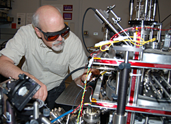 NIST researcher Jabez McClelland makes adjustments on the new magneto-optical trap ion source, capable of focusing beams of ions down to nanometer spots for use as a 'nano-scalpel' in advanced electronics processing.