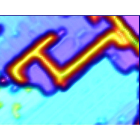 Figure 1: Scanning-tunneling microscopy image of acetophenone lines on a silicon surface. The lines of acetophenone can be seen as a bright orange line against the blue background of the surface.