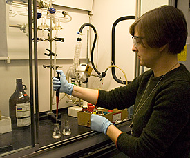 NIST researcher Ted Heilweil, National Research Council postdoctoral fellow Catherine Cooksey (pictured), and NIST Summer Undergraduate Research Fellow Ben Greer from Carnegie Mellon University have demonstrated the feasibility of a new technique for studying biomolecules using terahertz radiation. Because terahertz waves are almost completely absorbed by water, the team was able to reduce the amount of water to the bare minimum while still providing a realistic sample environment by using hollow, nanosized droplets called micelles as tiny test tubes.
