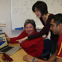 Professor Alice Parker, left, discusses the animation of a synaptic connector with graduate students Chih-Chieh Hsu, center, and Jonathan Joshi.