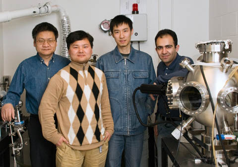 TEAM NANOTUBE - Members of UNL's Laser Assisted Nano-Technology Lab team who created self-assembling carbon nanotubes are (from left): professor Yongfeng Lu; post-doctoral researcher Yunshen Zhou; and graduate students Wei Xiong and Masoud Mahjouri-Samani. Photo by Greg Nathan/University Communications.