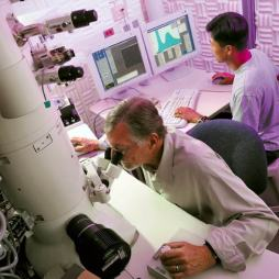 ASU School of Materials professor Ray Carpenter (at left) is pictured doing research with Ph.D. student Young-Chul Kim , using a high- resolution analytical transmission electron microscope at ASU�s J.M. Cowley Center for High Resolution Electron Microscopy. The center will be home to a new state-of-the-art aberration-corrected transmission electron microscope.