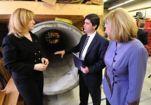 Brian Mergelas (centre), President and CEO of the Pressure Pipe Inspection Company (PPIC), shows Natural Resources Minister Lisa Raitt (left) and Sustainable Development Technology Canada (SDTC) President and CEO Vicky Sharpe (right) around the company's facility. SDTC and the Government of Canada announced today $53 million in funding to 16 emerging Canadian clean technologies. (MARKETWIRE PHOTO/Derek Oliver, CP)