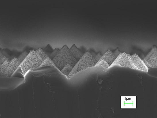 Image shows silicon pyramid structures etched for one minute using a hydrogen fluoride/hydrogen peroxide/water solution. The resulting structure has roughness at the micron and nanometer scales.