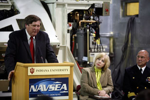 IU physicist and LINAC principal investigator Paul Sokol, left, IU Provost Karen Hanson and Crane commander Captain Charles LaSota were among the speakers at Monday's ceremony.
