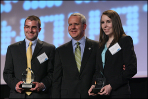Governor Brad Henry presents Chas Craig (left) and Shannon Jarmer with the Innovation Award during the 2009 Governor's Cup Competition.