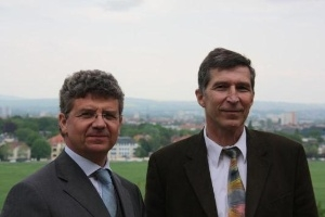 Prof. Stamm from the Leibniz Institute of Polymer Research (right) and Bruno Linn, Director Sales Europe from Carl Zeiss Nano Technology Systems division welcomed the guests. (Photo: Business Wire)