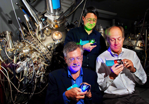 Sandia researchers Jerry Simmons (far left), Michael Coltrin, and Jeff Tsao (standing behind) check out solid-state lighting technologies