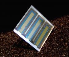 An organic photovoltaic cell on glass. The goal for UA scientists is to understand and control the interfaces in these devices at nanometer-length scales (less than 1/100,000 the thickness of a human hair) to enable the development of long-lived solar energy conversion devices on tough, flexible and extremely low-cost plastic substrates. Photo courtesy Neal Armstrong.