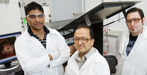 Rashid Bashir, a Bliss Professor of electrical and computer engineering and of bioengineering, center, led the researchers who developed a new solid-state nanopore sensor. He is flanked by graduate students Murali Venkatesan, left, and Sukru Yemenicioglu.