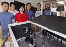 Research team members stand with equipment used for gyromagnetic imaging of gold nanostars. From left are graduate students Hyon-Min Song, Qingshan Wei and Dongmyung Oh; chemistry professor Alexander Wei; graduate student Jacob Hale; and associate professor of physics Kenneth Ritchie. (Purdue University photo/Andrew Hancock)