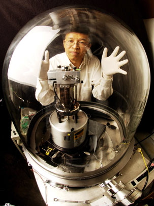 Professor Gang Chen with the vacuum chamber used in this research.