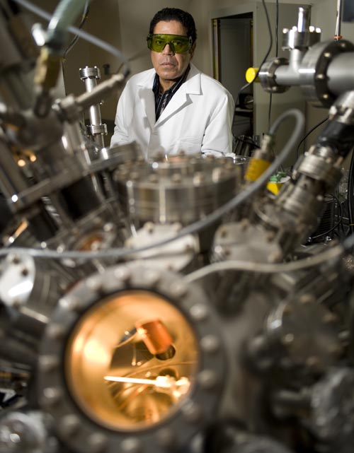 "Nuclear engineer Ahmed Hassanein works at his Purdue lab, where researchers are adapting the same methods used in fusion-energy research to develop a new type of ""nanolithography"" for creating future computer chips. Supercomputers at the U.S. Department of Energy's Argonne National Laboratory are needed to run simulations critical for the research. The technology revolves around extremely thin plasma beams for making tiny features in future computer chips and continuing Moore's law, an unofficial rule stating that the number of transistors on integrated circuits, or chips, doubles about every 18 months. (Purdue University photo/Vincent Walter)"