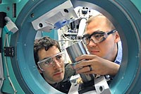 University of Chicago scientist Rafael Jaramillo and Argonne scientist Yejun Feng study the element chromium at the Advanced Photon Source, one of the Argonne facilities to be upgraded with funds from the Recovery Act.