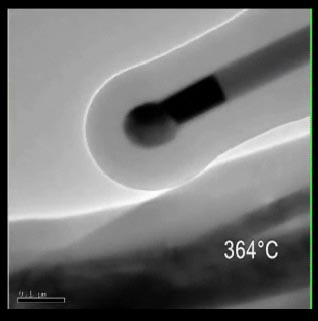 A still shot from the video of the nano test tube experiment conducted in the lab of Brian Korgel, professor in the Department of Chemical Engineering at The University of Texas at Austin.  The video shows gold moving up the length of a germanium nanowire, which was encased in a carbon nano test tube, at high temperature. The image has been magnified 100,000 times and the video's speed has been greatly increased.
