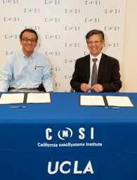 Tak Takimizu (left), president of Photron USA Inc., and Paul S. Weiss, director of the California NanoSystems Institute at UCLA