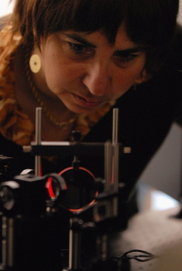 Prof. Luisa De Cola and a light emitting diode (LED) 