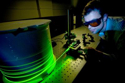 A researcher is testing an optical fiber system in the Institute for Photonics & Advanced Sensing, University of Adelaide. Credit: Photo by Jennie Groom.