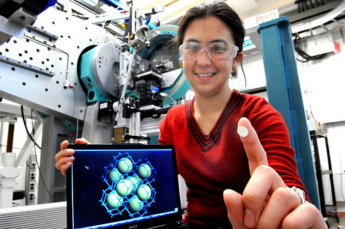 Argonne scientist Karena Chapman holds up a wafer of metal organic framework ZIF-8 with its structure displayed on the computer screen. Chapman along with scientists Peter Chupas and Gregory Halder were able to change the structure of a metal organic framework at pressures low enough for large scale industrial applications.