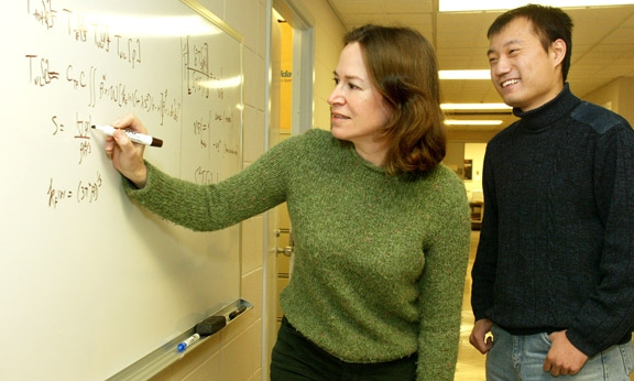 Professor Emily Carter and doctoral student Chen Huang developed a new way of predicting important properties of substances. The advance could speed the development of new materials and technologies. (Photo: Frank Wojciechowski)