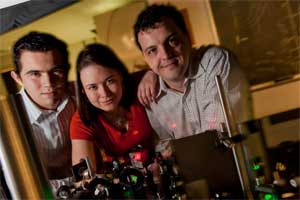From left, Rice graduate students Sergio Dominguez-Medina, Liane Slaughter and Alexei Tcherniak, co-authors (with Stephan Link and Ji Won Ha) of a new paper investigating the plasmonic properties of nanoparticles as they relate to a century-old theory. Courtesy Jeff Fitlow.