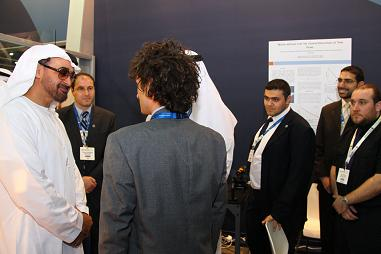 Dr. Matteo Chiesa (foreground) and Asylum Research's Mick Phillips (right) discuss AFM solar energy applications with visitors to the MASDAR LENS booth, including His Highness General Sheikh Mohamed bin Zayed Al Nahyan, Crown Prince of Abu Dhabi (left).