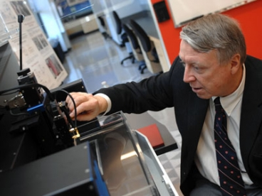 Edwin L. Thomas, head of the Department of Materials Science and Engineering and the Morris Cohen Professor of Materials Science and Engineering, uses a Scanning Acoustic Microscope in MIT's Laboratory for Advanced Materials. Photo: Patrick Gillooly